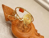 Wrought copper bracelet wet with gold, with spiral and corniola stone