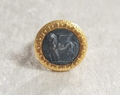 Reproduction of gold wet brass ring. Tarquinia-based centre with alate horses