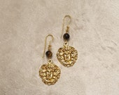 Gold wet brass earrings with Medusa face and pearl in tiger eye