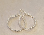 Braided hoop earrings made of silver wet wrought copper