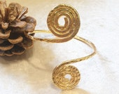 Gold wet beaten copper wrist bracelet, with double spiral