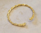 Gold wet brass braided bracelet with ram head endings