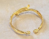 Gold wet brass bracelet. Formed by a shadow couple of the evening