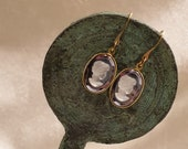 Brass earrings with cameo depicting woman's profile
