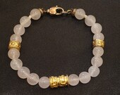 Pink quartz pearl bracelet with wet gold details.