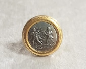 Reproduction of gold wet brass ring. Central with dancer and double aulos player of Tarquinia
