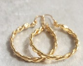 Braided hoop earrings made of wrought copper bathed in gold