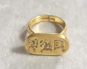 Handcrafted ring in gold wet brass. Engraving depicting the Capitoline wolf, a griffin and the chimera
