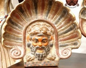 Reproduction of etruscan terracotta antephyss. Satyn with lion fur. Height 27 cm, width 30 cm