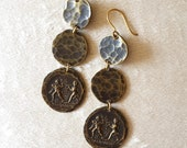 Handmade brown brass earrings with series hoops. Finale with dancer and double aulos player