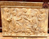 Reproduction of a bas-relief panel in terracotta. Grooming scene with 5 women