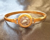 Rigid bracelet antique style, central with athena owl