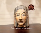 Reproduction of etruscan face of polychrome terracotta menade. Height 19 cm