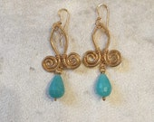 Gold wet beaten copper earrings, with double spiral pattern and turquoise stone drop pendant