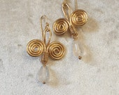 Gold wet beaten copper earrings, with double spiral pattern and crystal stone drop pendant