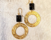 Brass earrings with gold bath. Circle pendant with Capitoline wolf and chimera interspersed with palmettes. Onyx stone