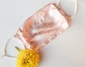 Beautiful pink floral silk face mask that is designed to be protective, reusable, and add a pop of color for a trendy accessory