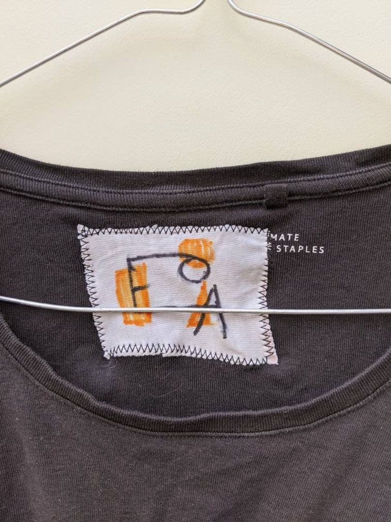 Up-cycled t-shirt machine and hand embroidered