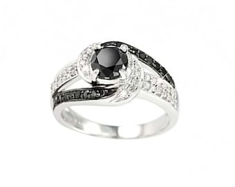 sale price over 40 diamonds and a black 1crt diamond in centre ring     comes in gift box