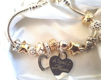Gold Silver Charm Bracelet With Special Mum charm and 12 other charms gift boxed