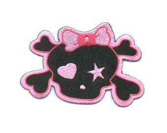 pink skull and cross bones with bow. embroidered iron / sew on patch ideal clothing,most fabric etc