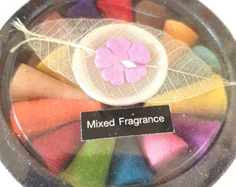 round gift box of incense cones and holder for cones  mixed scents ideal gift or for own use