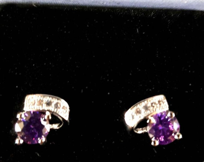 amethyst studs on sterling silver earrings  claw set, 1 mainstone and 5 clear crystals in gift box