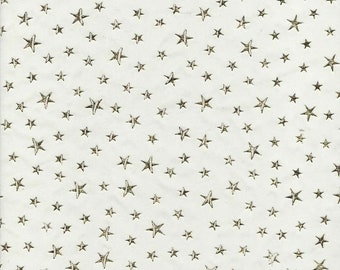gold stars on organza gold . 29cm wide sold by the metre