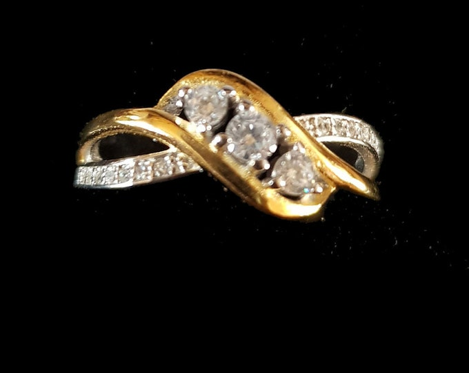 triple diamond and gold and white gold ring    comes in gift box