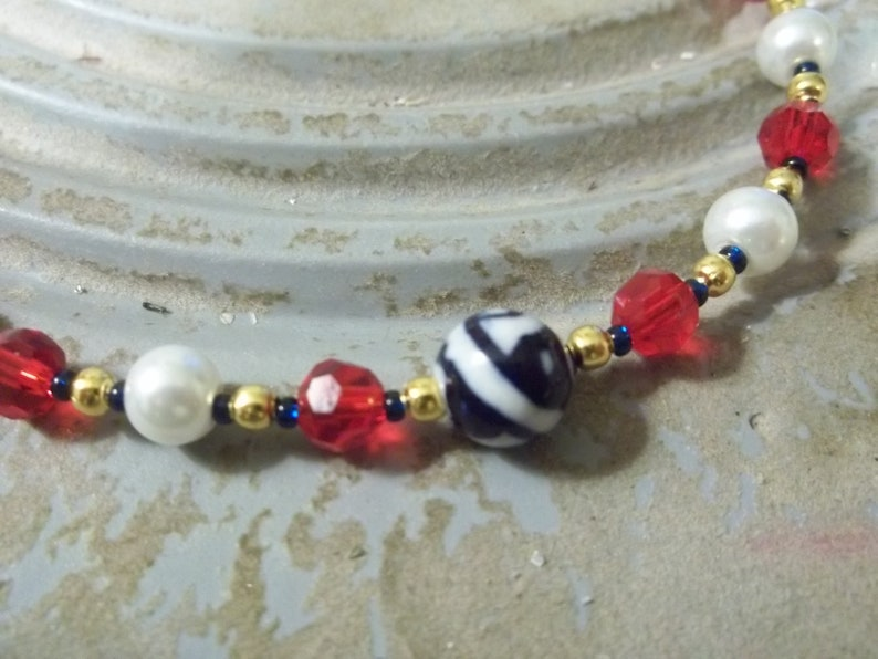 2 necklace set one necklace is 19 inch with blue as primary color and second necklace is 17 inch with red as primary color