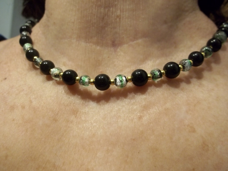 green black and gold beads 2 necklace set one 19 inch and one 18 inches