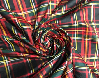 """Beautiful black red green yellow Silk taffeta plaid light weight. 45"""" wide. Best used for Appearel.  Sold by the yard"""