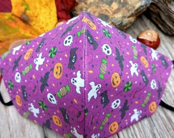 Trick or treat handmade 3 layer contoured cotton facemask. In super cute Halloween print on purple, with magenta lining & extra soft elastic