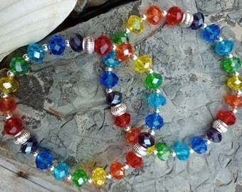 Rainbow crystal handmade bracelet. Super cute bracelet with sparkling faceted glass crystals in rainbow shades. Lovely cheerful little gift.