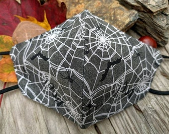 Spooky spiderwebs handmade 3 layer contoured cotton facemask with extra soft elastic earloops and opening for optional filter insert.
