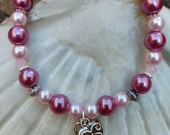 Handmade pearl bracelet with key and heart charms. Gorgeous antique rose glass pearls & tibetan charms perfect gift for someone special.
