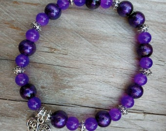 Purple Passion handmade bracelet, gorgeous dark purple beaded bracelet with filigree heart charm on strong clear stretch cord.