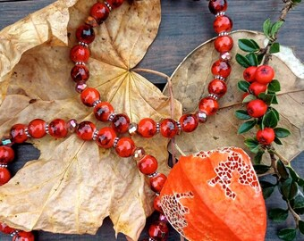 Autumn spice handmade bracelet in lovely burnt orange marble glass beads and rainbow copper plate faceted crystals.