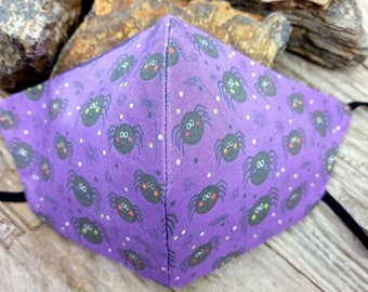 Purple Spiders handmade 3 layer contoured cotton facemask, with extra soft elastic earloops and purple cotton lining.