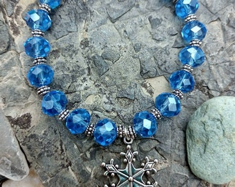 Crystal Snowflake handmade bracelet. With sky blue faceted glass crystals and tibetan style snowflake charm.