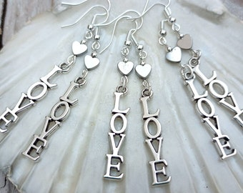 Love charm handmade earrings. With silvered Hemitite heart beads and silver plated metal LOVE charm.