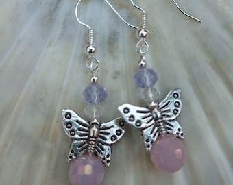 Butterfly earrings. Silver butterflies on soft pink opal crystals. Pretty little gift.