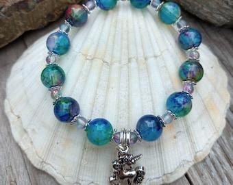 Rainbow marble handmade beaded bracelet with silver unicorn charm. Funky, chunky and cute.