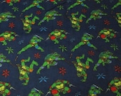 "Character Flannel Fabric - Teenage Mutant Ninja Turtles on Navy Blue - 22"" REMNANT - 100% Cotton Flannel"