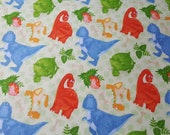 """Flannel Fabric - Dinosaurs and Tracks on Green - 28"""" REMNANT - 100% Cotton Flannel"""