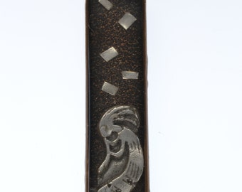 Silver and bronze kokopelli pendent sealed in resin