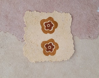 two printed flowers on paper