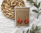 Circular Terracotta Polymer Clay Drop Earrings with White Painted Abstract Face
