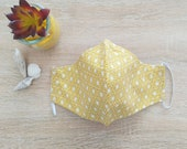 Consumer protective mask in multilayered cotton fabric Size WOMAN Pattern gold flowers