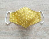 Fabric consumer protective mask, ADO. Golden flower pattern